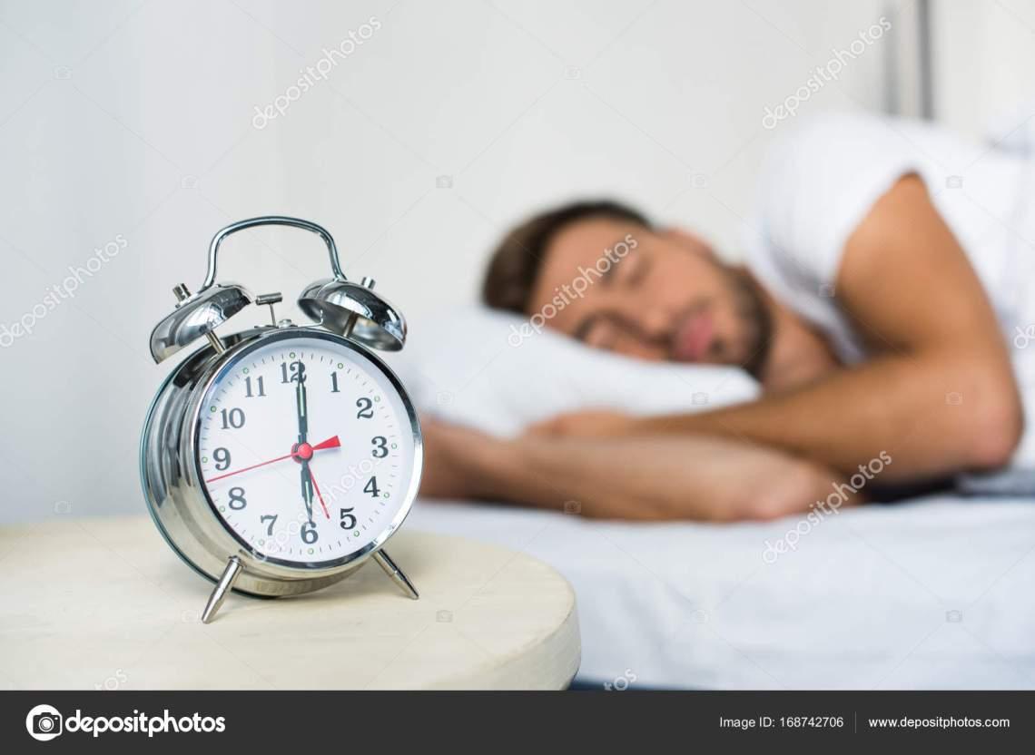 Cool Alarm Bedside - depositphotos_168742706-stock-photo-alarm-clock-on-bedside-table  2018_751170.jpg