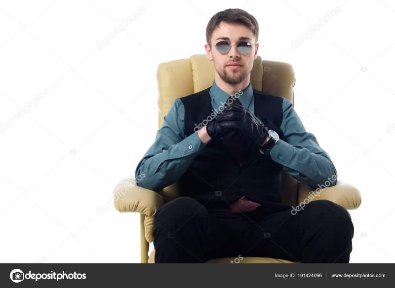 Spy sitting in chair