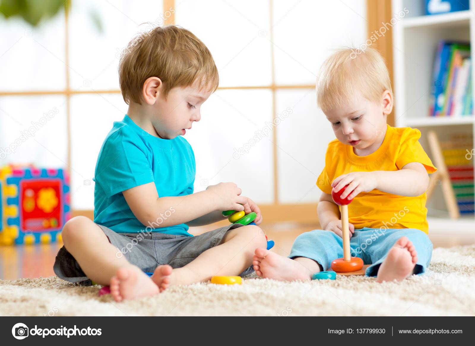 Children Play With Educational Toys In Preschool Or