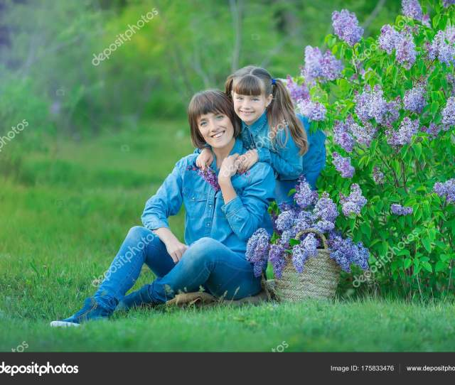 Cute Adorable Beautifull Mother Lady Mom Woman With Brunette Girl Daughter In Meadow Of Lilac Purple Bush People In Jeans Wear Photo By Dlukashenko Mail