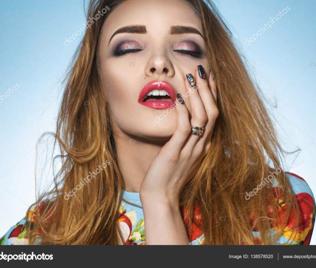 Sexy Girl With Closed Her Eyes And Opened Mouth Keeps Hand On Face Stock Photo