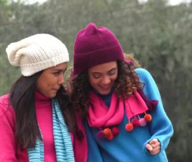 Latina Girls Having Fun Wearing Sweaters In Cold Stock Video