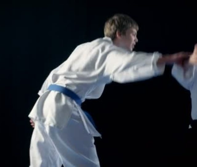 Martial Arts Aikido Master Wearing Hakamas Teaches Young Student How To Defend Himself Against An Attack