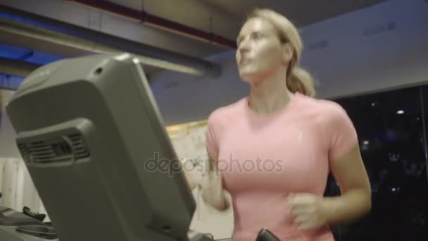 Group Of Adult Women Exercising On Treadmill Stock Video