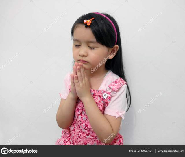 Cute Little Asian Girl Closing Her Eyes And Praying Stock Image
