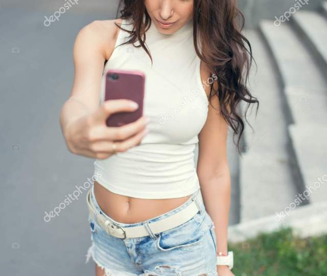 Beautiful Sexy Girl Taking A Selfie In The Street Stock Photo
