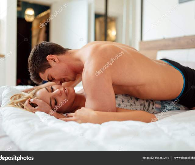 Couple Sensual Foreplay In Bed While Lying On Bed Photo By Nd3000