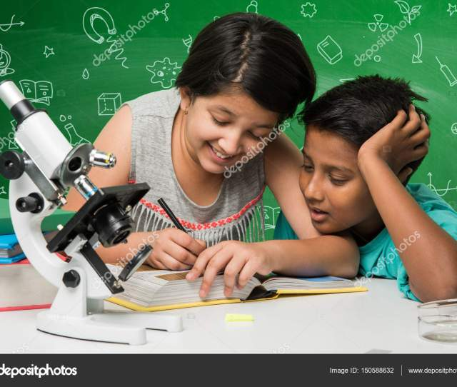 Kids And Science Concept Cute Indian Little Kids Busy Doing Chemistry Or Science Experiment With Test Tube And Flask With Safety Eye Glass Over Green