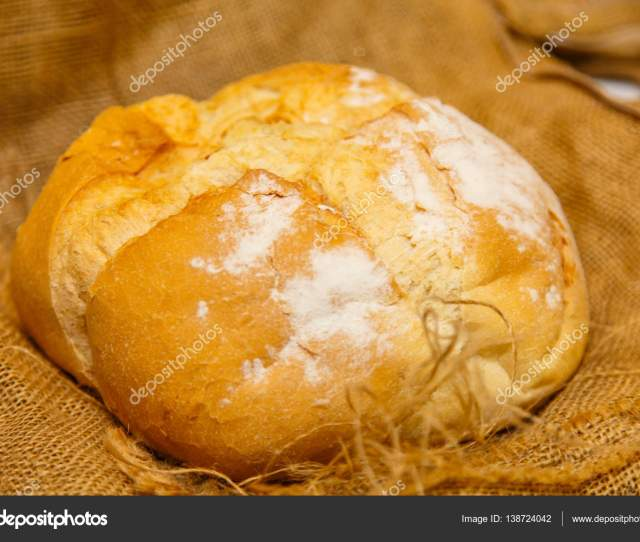 Homemade Round Bread From Wheat Flour Lies On Rough Cloth Stock Photo