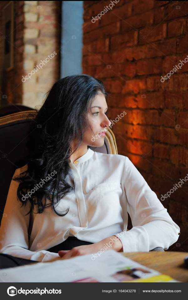 Young girl in the cafe does business. Office worker on ...