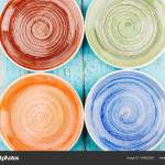 Colored Ceramic Plates On The Blue Wooden Background Stock Photo Image By C Lisssbetha Gmail Com 180652252