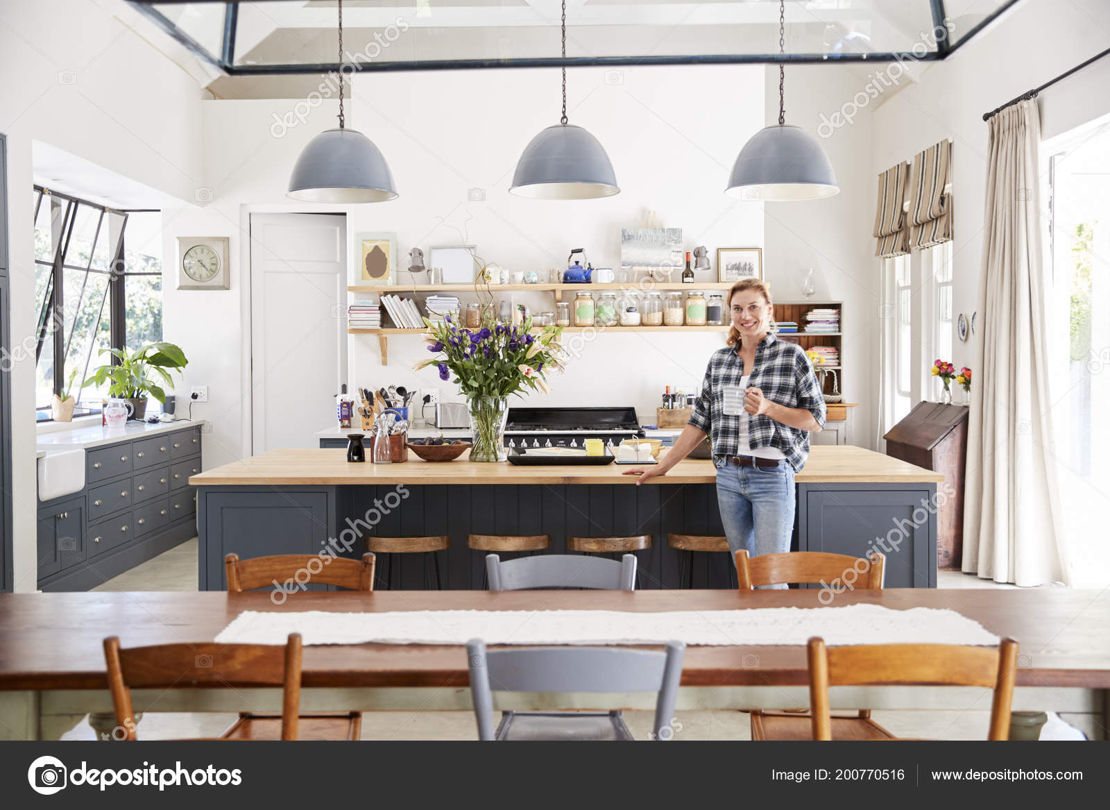 Woman Leaning Island Open Plan Kitchen Dining Room Stock