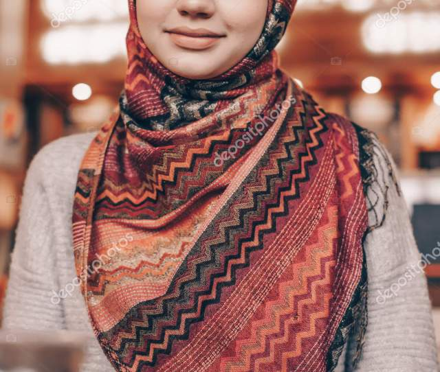 Charming Arab Girl With A Beautiful Headscarf At Her Dinner In A Cozy Cafe Looks At The Camera And Smiles Stock Image
