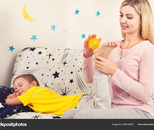 Mom Does Foot Massage Her Son Stock Photo