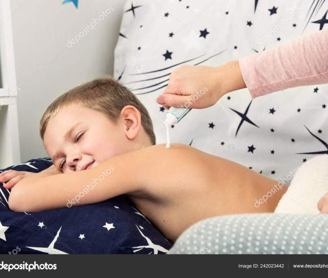 Mother Makes Massage Back His Little Son She Smears Her Stock Photo