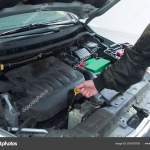 Performing Car Repair In A Home Garage To Provide Safe Transportation Stock Photo C Timothyoleary 251878105