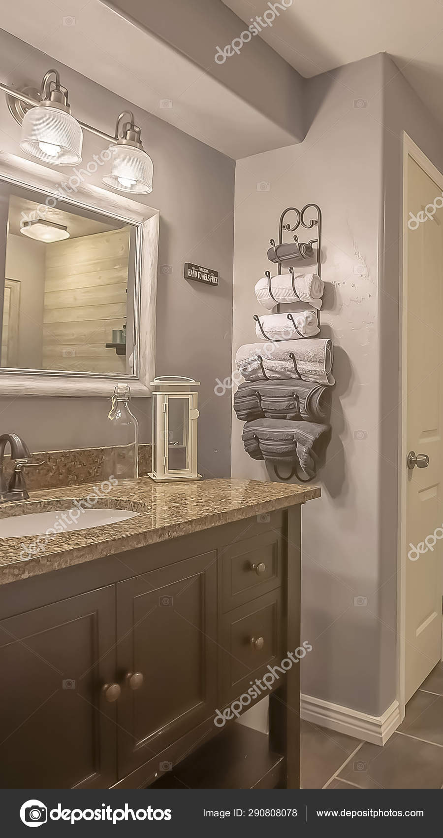 vertical mirror and lamps above the vanity inside a bathroom with towel rack and shelves stock photo image by c dropthepress gmail com 290808078