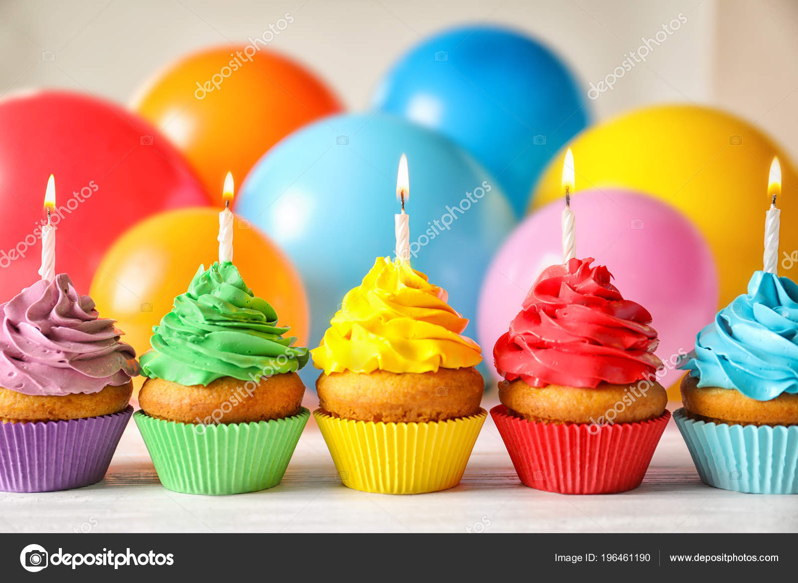 Delicious Birthday Cupcakes Candles Blurred Balloons