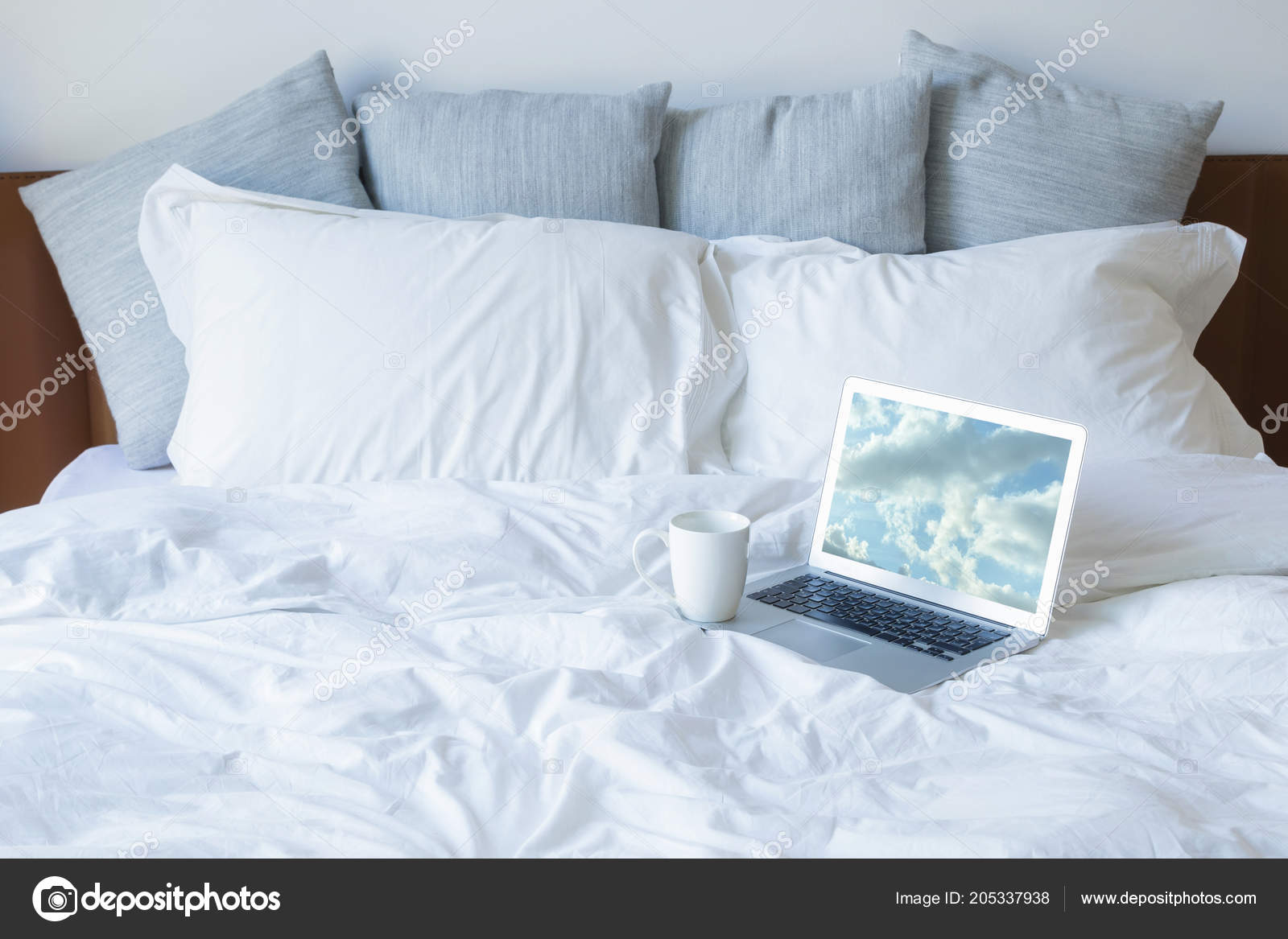 https depositphotos com 205337938 stock photo laptop cup coffee bed lot html