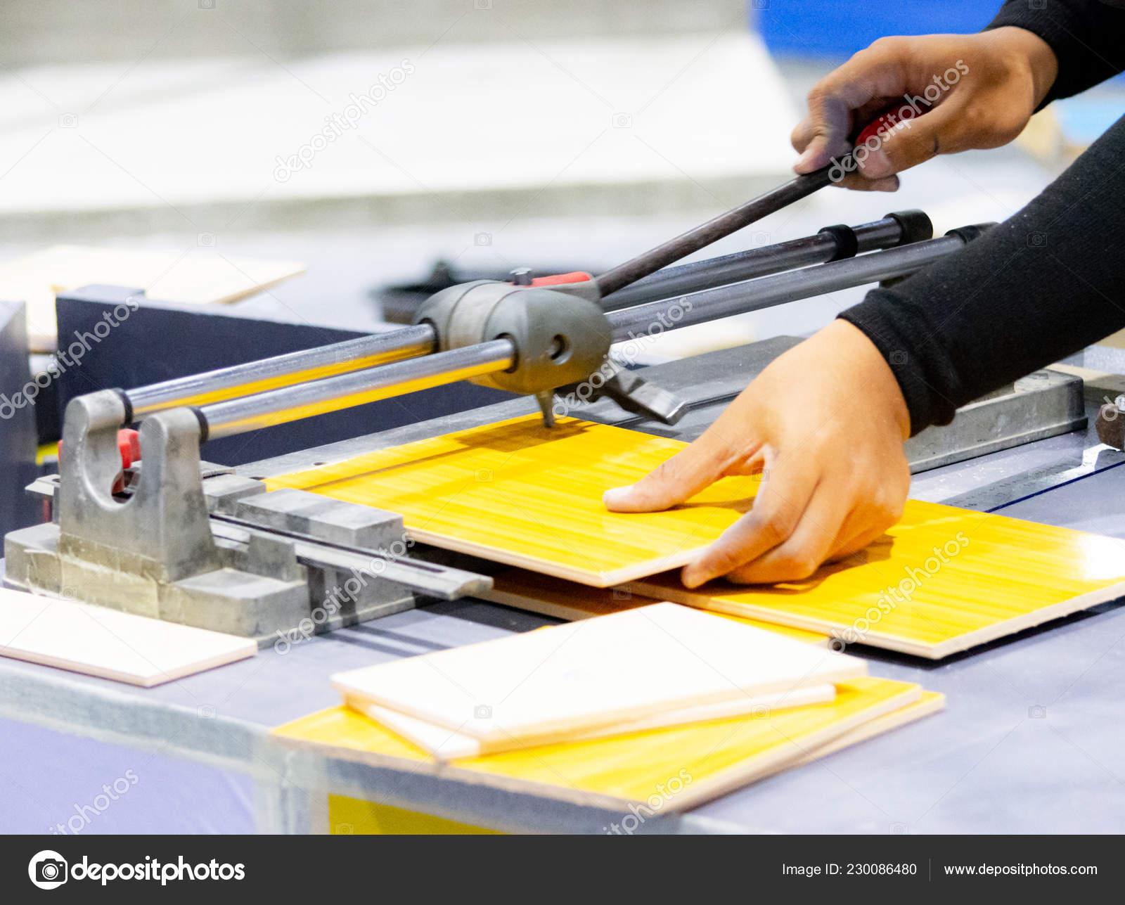 cutting floor tiles using tile cutter machine cutting ceramic tiles stock photo image by c prarinya 230086480