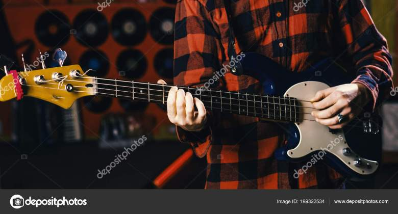 musician, artist play electric guitar musical instrument. male hands