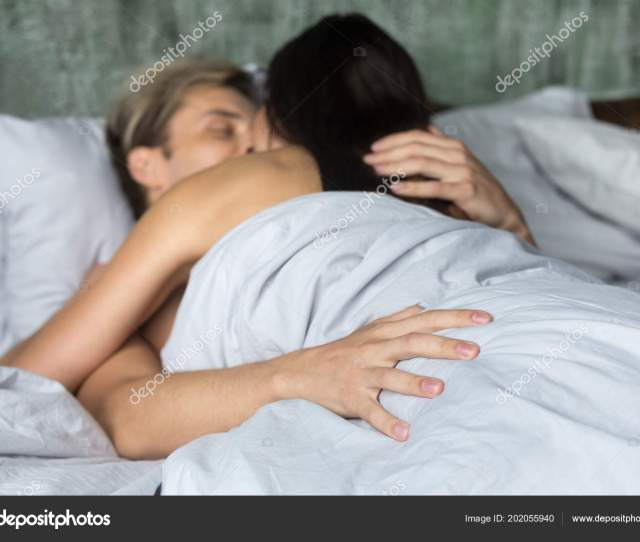Young Couple Having Slow Sensual Sex Under Blankets Stock Photo
