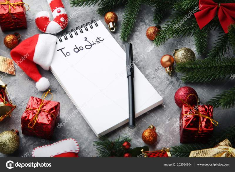 list notepad christmas decorations wooden table stock photo - Christmas Decorations List