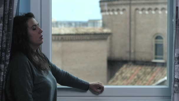 Image result for a woman thinking by the window