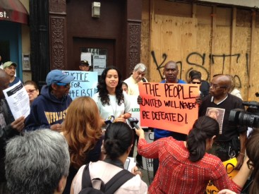 Carlina Rivera of Good Old Lower East Side speaks in support of a building of Mexican tenants whose landlord is trying to force them out of their apartments.