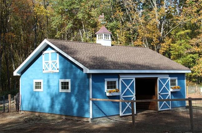 Custom blue horse barn