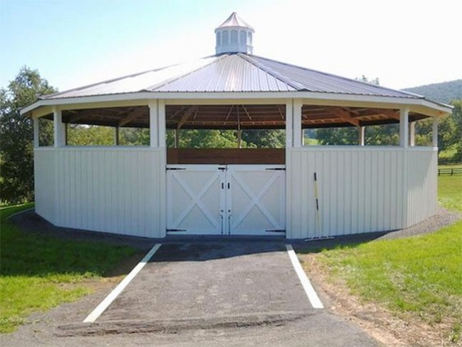 Beautiful white wooden round pen with a roof