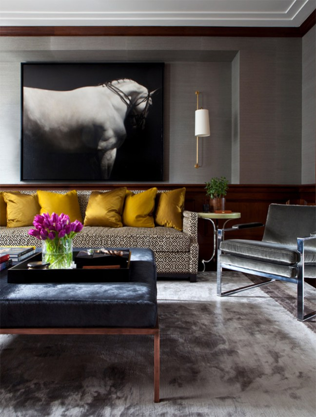 black and white horse art over the couch