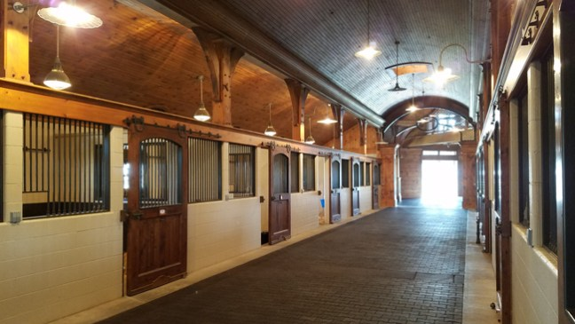clean stable aisle with brick pavers
