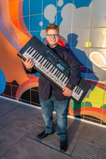 Portrait with a keyboard and an artistic background