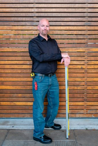 Photo of a Contractor in front of a wooden wall