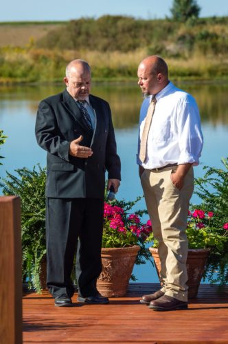 Groom and Minister talk before the ceremony