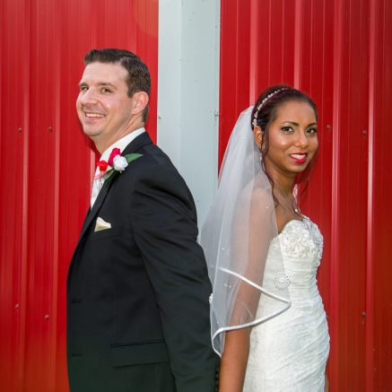 Bride and groom stand back to back before seeing each other fir the first time.