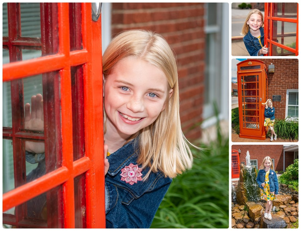 Girl poses with a British Telephone booth.