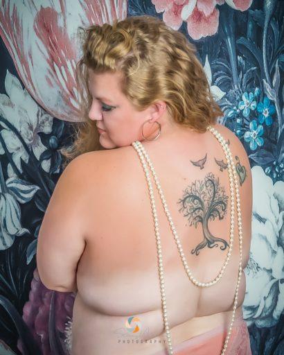 Confident partial nude boudoir model.