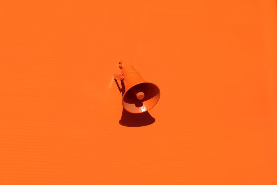 Orange megaphone on an orange background