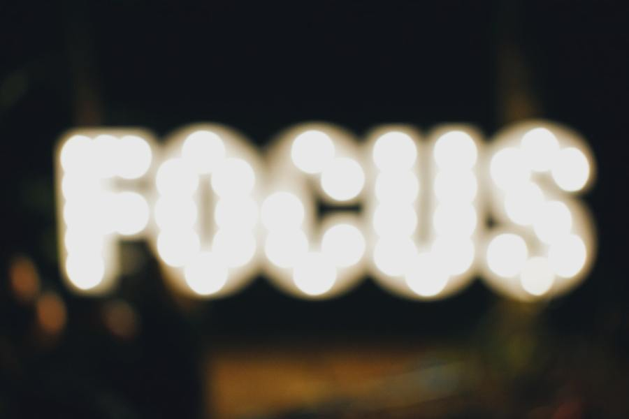 Slightly out of focus picture of the word Focus spelt out in lights