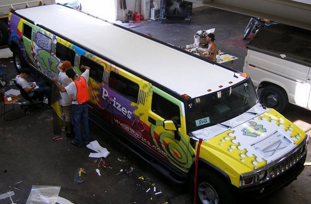 Steve Stachini BIO pic - A luxury Hummer limousine vehicle wrapped in a cartoon coloured graphic design for ITZ promotions.