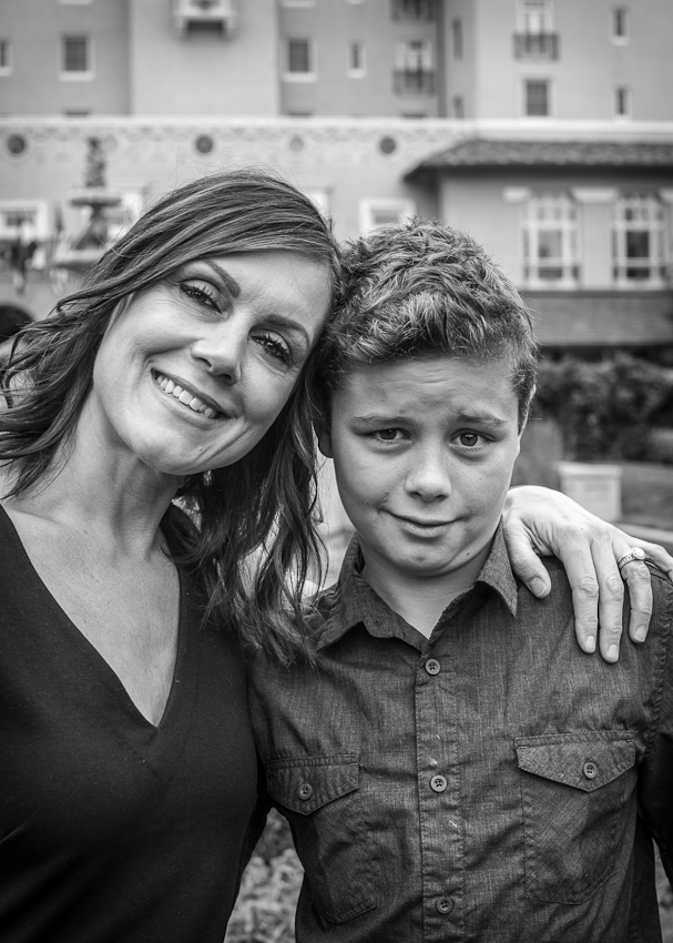 B&W photograph of a mom and son in front of the Broadmoor Resort