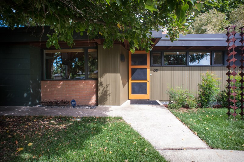 mid century modern exterior, yellow door, brick and wood