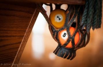 pool balls in billiard pocket