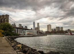 Jane's Carousel in Brooklyn Bridge Park, backdropped by Brooklyn Bridge and One World Trade Center.