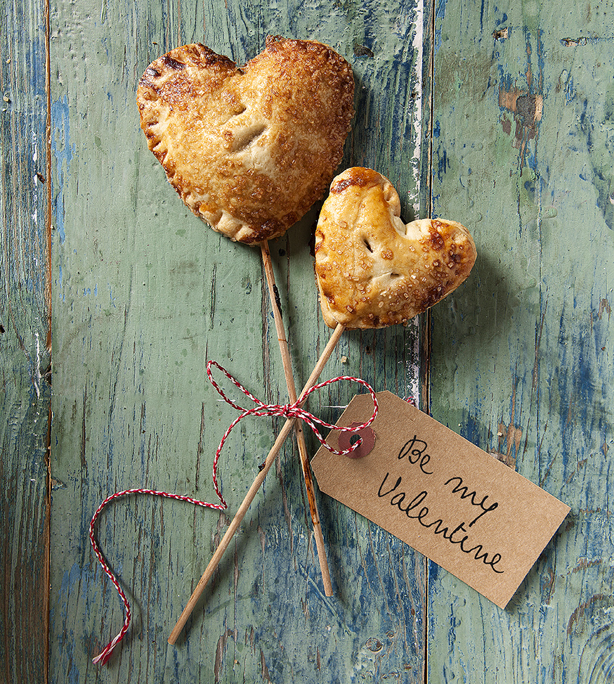 two different sized heart shaped cherry pies on popsticks by Stacy Grant