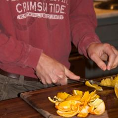 removing peel and pitch from orange's flesh to make candied orange peels