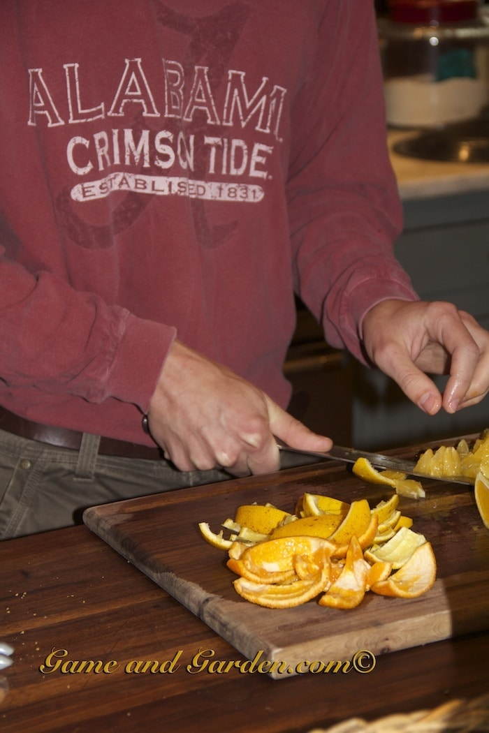Remove the peel and pith from the orange's flesh.