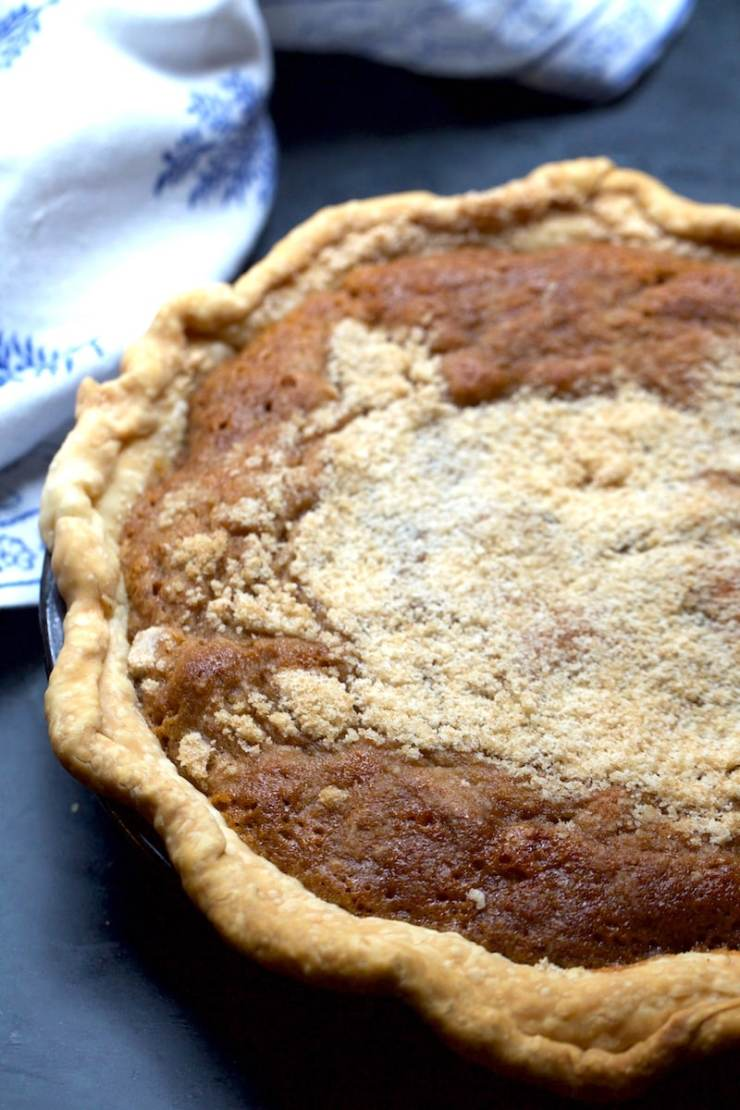 Spicy Southern Pie has the texture of a chess pie and the spices of a pumpkin pie! It's super great for the holidays with ice cream or just about anytime.